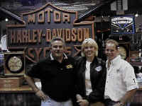 Jon and Bev of Eastside Harley with 9xGNC Scott Parker